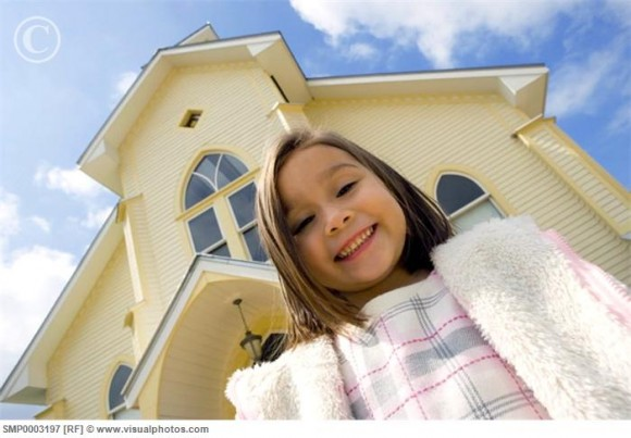 Young girl outside a church
